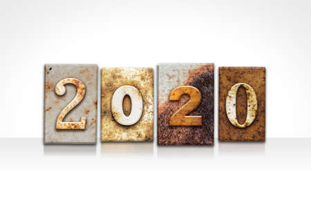 The year 2020 written in old vintage letterpress type isolated on a white background