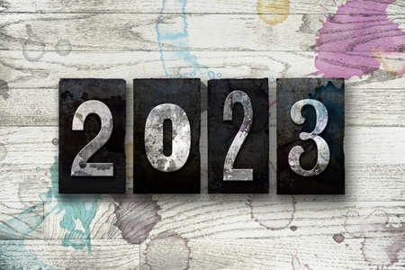 The year 2023 written in old vintage letterpress type.