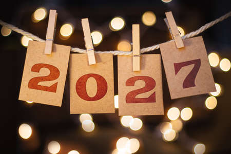 The year 2027 written on pinned cards hanging from a string.