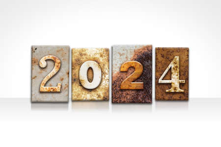 The year 2024 written in old vintage letterpress type isolated on a white background