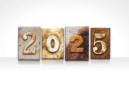 The year 2025 written in old vintage letterpress type isolated on a white background