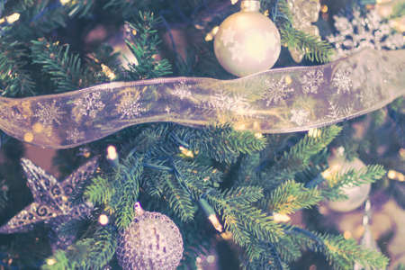 A closeup of a decorated Christmas tree with lights and silver ornaments. 免版税图像