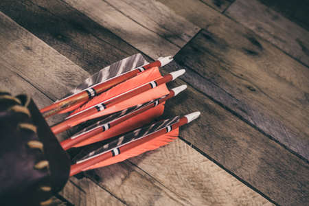 A traditional archery quiver full of traditional wooden arrows.