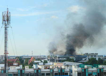 Fire burning and black smoke over the factory