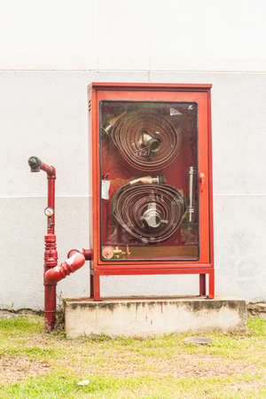 extinguish: Hydrant with water hoses and fire extinguish equipment