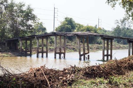 unavailable: Old wooden bridge is broken unavailable.