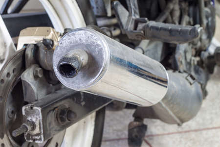 lubricator: old exhaust tube of motorbike have the oil stick Stock Photo