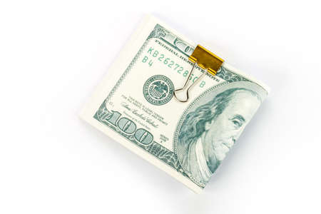 ben franklin money: One hundred dollars banknotes in money clip isolated