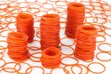 rubber bands: many heap red a rubber bands Stock Photo