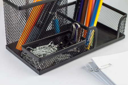 paper clips: Paper clips in a black metal box.
