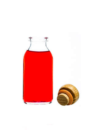 red water: red water in glass bottle on a white background Stock Photo