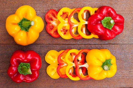 colorful of paprika on a wood background