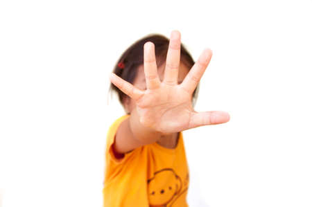 child showing hand signaling to stop, useful to campaign against violence