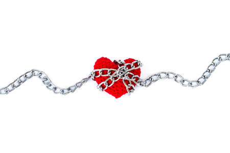 special steel: red heart shape entwined with chains on white background Stock Photo