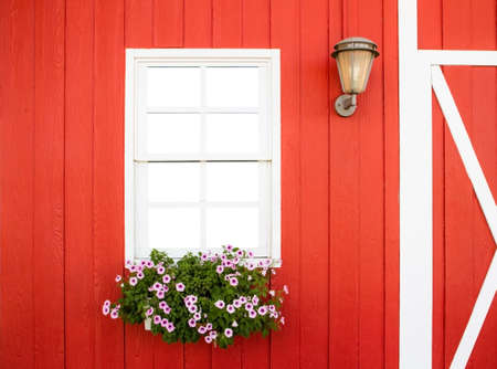 flower box: white window on red wall with flower box and lamp Stock Photo