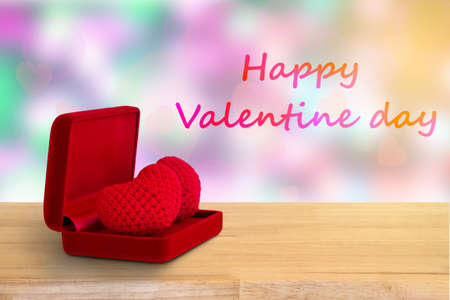 red heart in red box on wooden floor , valentines day background