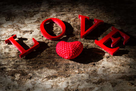 Word LOVE on old wood background. vintage style Stock Photo