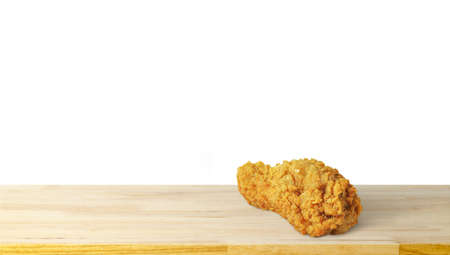 crispy fried chicken on wood plate isolated on white background