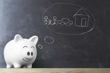 Piggy bank dream against chalkboard, Savings for the future Imagens