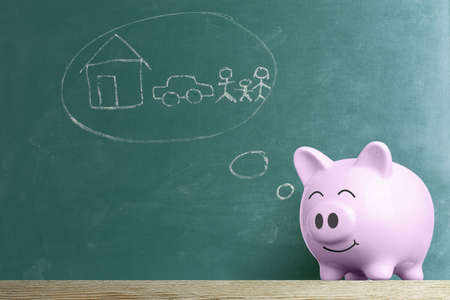Piggy bank dream with against green chalkboard, Savings for the future