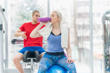 Fitness couple woman and man exercise workout in the gym Stock Photo