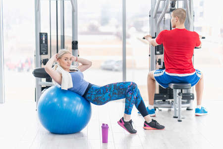 Fitness couple in the gym workout
