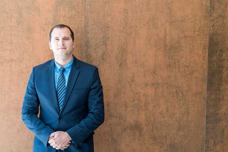 Handsome confident businessman portrait. Portrait of a handsome CEO. Handsome executive business man at the workspace office