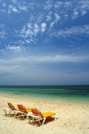 tropical beach, perfect place for relaxing in folding beds