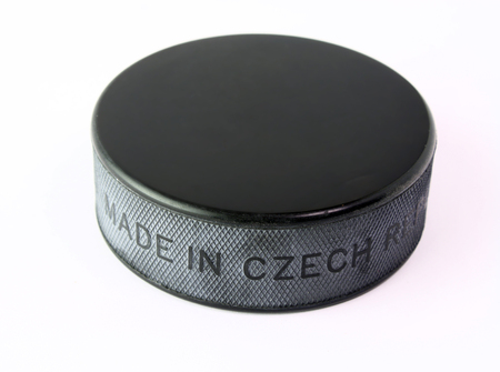 A black hockey puck isolated on white background