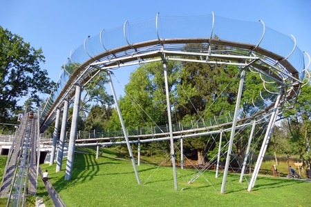 Curved bobsleigh track ramp with protective cage, fun resort