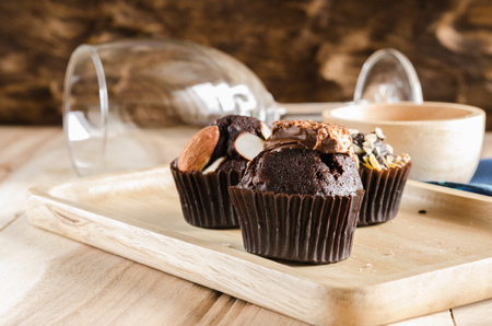 cake topping: cup cake topping with chocolate wafer on wooden