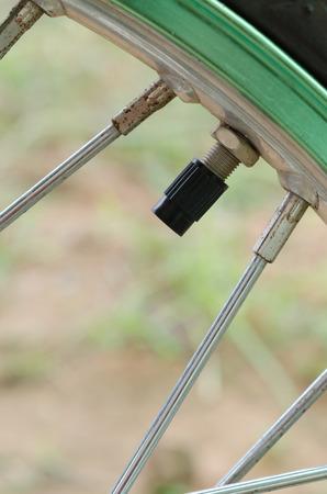 spoke: tire valve stem and spoke