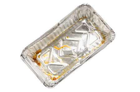clear away: Dirty used amluminium foil tray on white background with clipping path Stock Photo