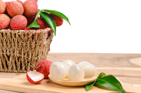 lechee: peeled lychees on wooden table and white background with clipping path