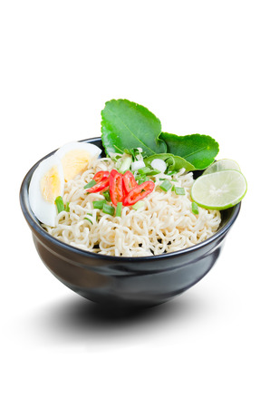 cooked instant noodle: instant noodle cooked spicy in black bowl on white background with clipping path