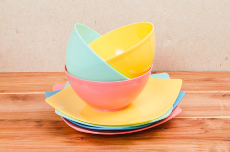 tupperware: colorfull kitchenware is on center of wood-table