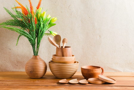 kitchen ware: collection of wood kitchen ware for decoration include vase, set of bowl, spoon, and cup