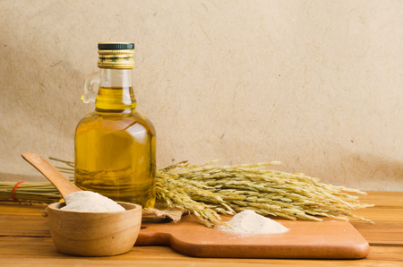 bottel of rice bran oil extracted from rice bran. Healthy for cooking.