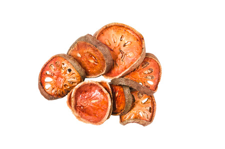 isolate heap of dried bael fruit on white with clipping path