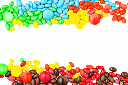 heap of colorful button-shape chocolate on white background