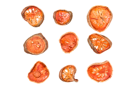 group of isolated dried bael fruit on white with clipping path for drinking.