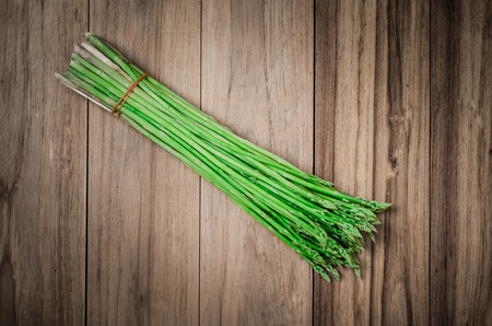 tied asparagus put on wood, agriculture plant a kind of vegetable is growth in spring