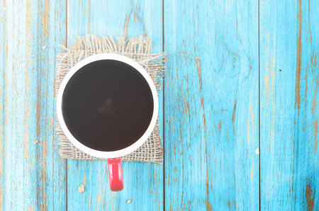 red cup of coffee on blue-old wooden table, hot coffee, black coffee