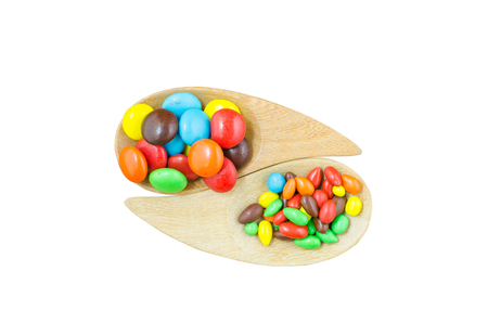 colorful button shape candy, made from chocolate and peanut coated with different color on white background