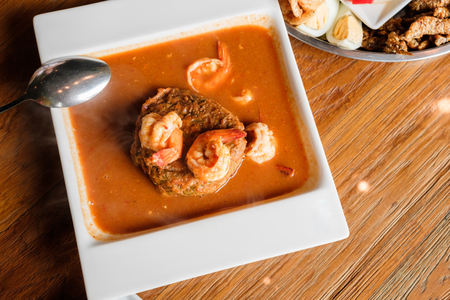 top view of Acacia omelets and fresh shrimp in vegetable sour soup with copy space Stock Photo