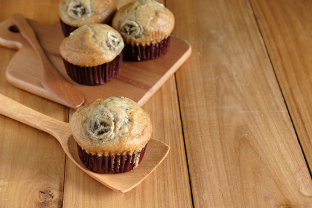banana cup cake put on wood table with copy space Stock Photo