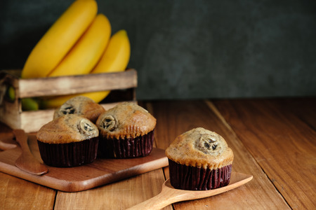 banana cup cake put on wooden table with copy space for any text