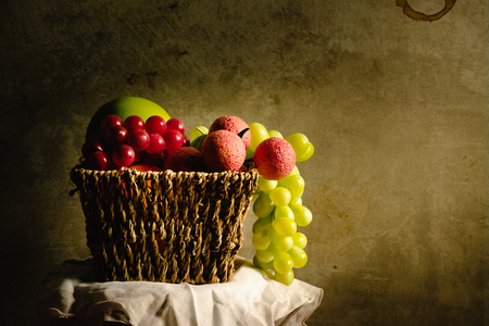 fruit photo in retro style or fruit still life with light painting for art decoration with a concrete textur wall and copy space for any text