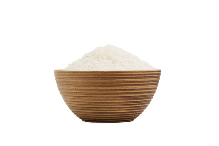 isolated rice in wooden bowl  on white background