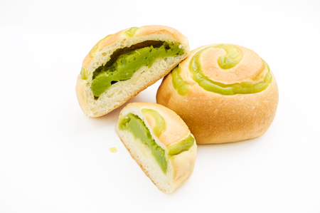 bread filled with pandanus custard was cut and put on white background